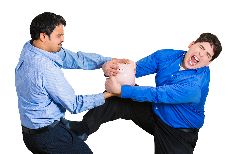 Closeup portrait of two funny looking men, one trying to steal piggy bank from guy holding it tightly, trying to protect his savings, isolated on white background. Financial fraud, robbery. Emotions
