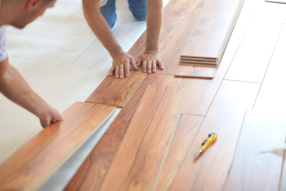 Installing laminate flooring in new home indoor