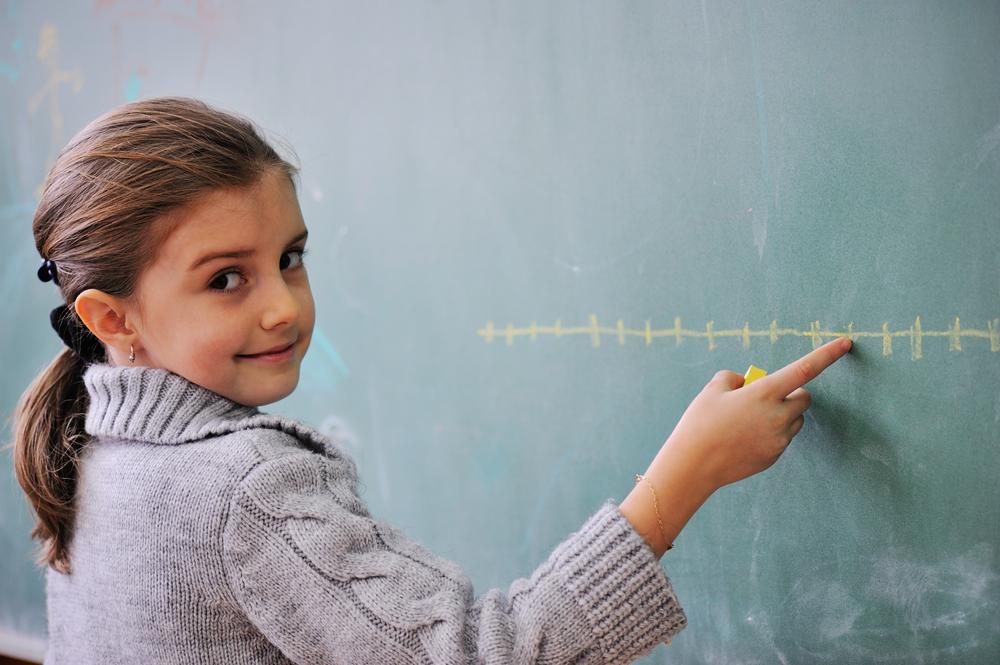 Schoolgirl draws a graph