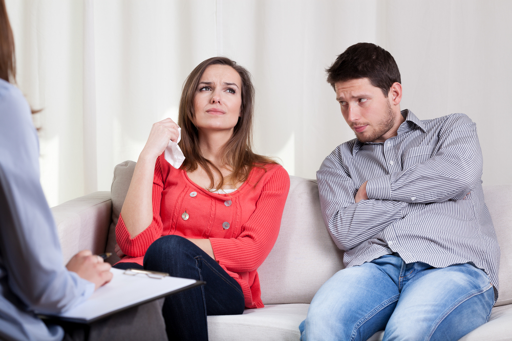 Young unhappy couple on special marriage therapy session